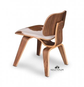 Ergonomic valnut dining chair covered with real cow skin. Illustration cow skin brown-white.