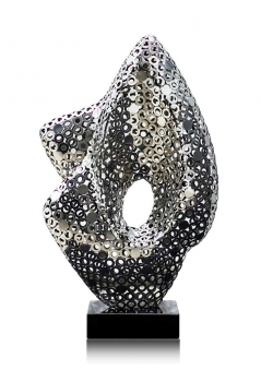 ABSTRACTLY SCULPTURE A FIREWORK OF FILIGRANE CRAFTSMANSHIP MADE IN POLISHED STEEL
