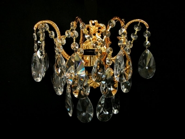 Wall light with real lead crystals, available in gold or silver. Matching chandelier available.