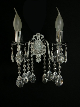 Wall light with solid metal base and real crystals.