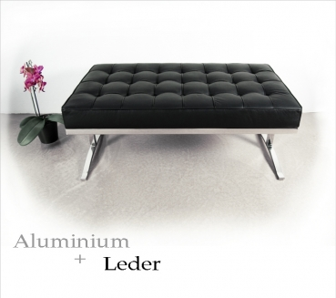 Eyecatcher bench with finest leather and polished aluminium legs.