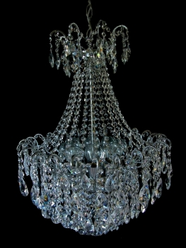 Crystal chandelier with 32 arms and 8 illuminates.