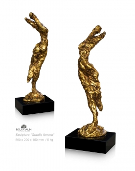 Abstract dancing sculpture on black marble pedestal. Height 56 cm.