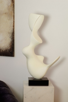 Abstract sculpture mat white creme painted on black marble plinth. Height 73 cm.