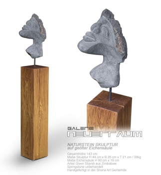 Head stone sculpture handmade in Springstone based on oiled german oak column. Total height 143 cm.