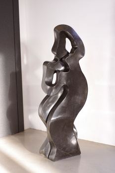 Abstract Lovedance stone sculpture hand carved from one pieces of Springstone. Height 77 cm. 26 kg.
