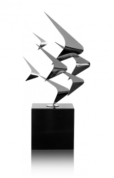 Abstract stainless steel scalare sculpture glossy polished on marble pedestal. Height 66 cm.