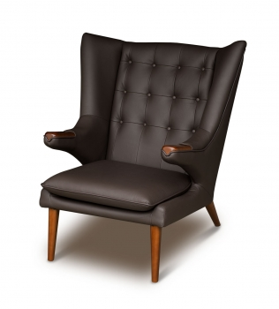 Vintage leather wing ear chair in dark brown with solid walnut wood applications.