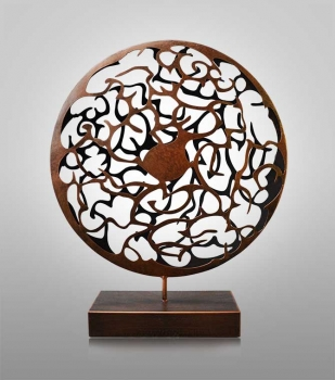 Round painted iron sculpture in mat brown . Height 60 cm.
