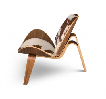 Cow skin valnut lounge chair with real valnut veneer and real cow skin.