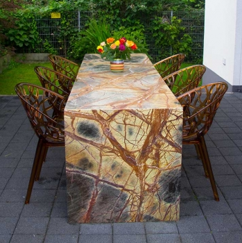 Large stone table made in rainforest brown natural stone.