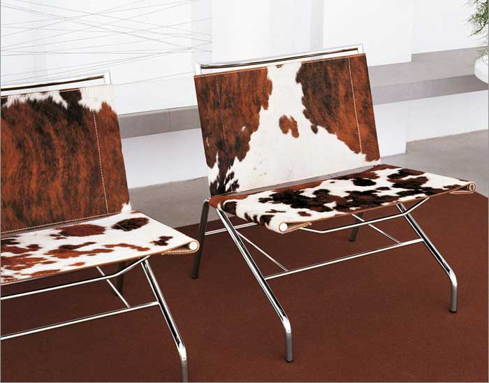 Attirant Amazing Pony Hide Lounge Chair With A Stainless Steel Base. Cow Skin Brown  White.