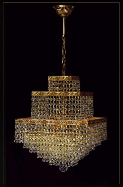Oriental cube gold chandelier with ornamentation and 4 illuminates.